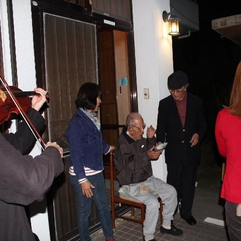 Caroling at the house of a church member. He recently came to Jesus.